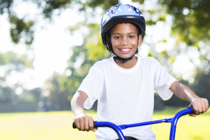 smiling boy on a bike